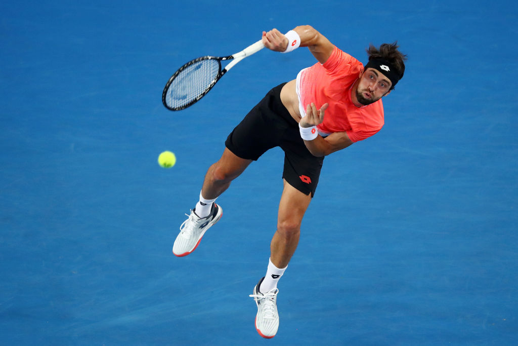MELBOURNE, AUSTRALIA - JANUARY 18: Nikoloz Basilashvili of Georgia serves in his third round match against Stefanos Tsitsipas of Greece during day five of the 2019 Australian Open at Melbourne Park on January 18, 2019 in Melbourne, Australia. (Photo by Julian Finney/Getty Images)