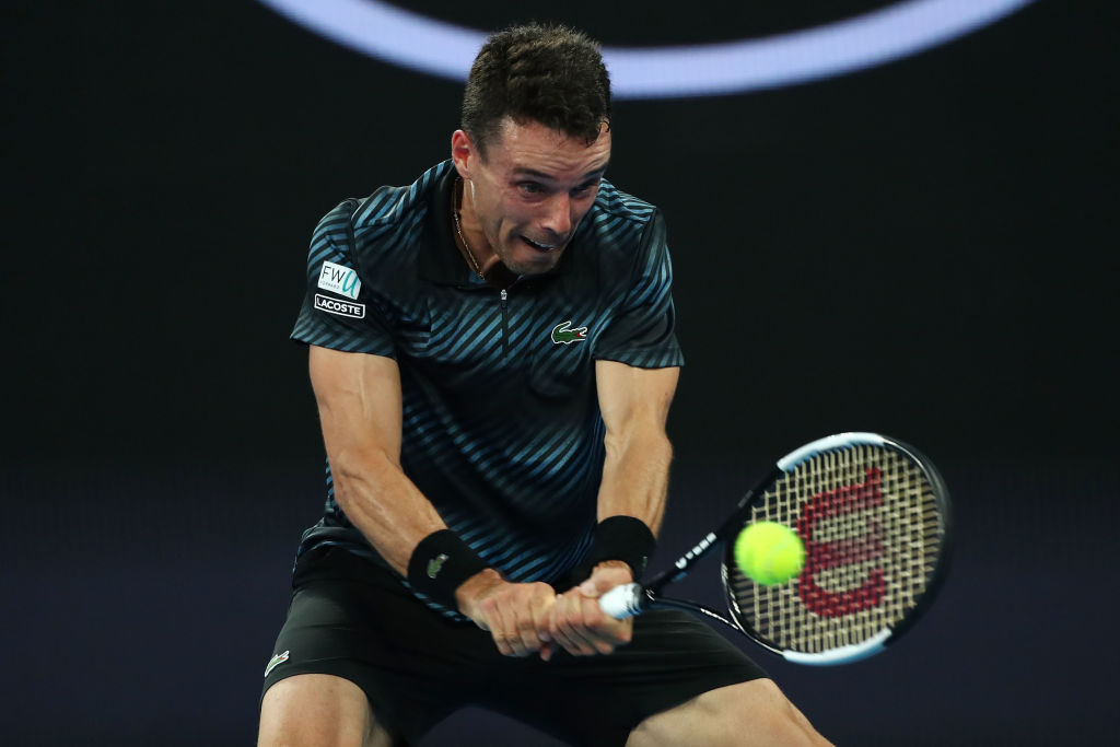 MELBOURNE, AUSTRALIA - JANUARY 14: Roberto Bautista Agut of Spain plays a backhand in his first round match against Andy Murray of Great Britain during day one of the 2019 Australian Open at Melbourne Park on January 14, 2019 in Melbourne, Australia. (Photo by Cameron Spencer/Getty Images)