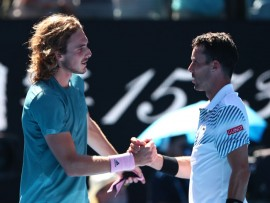 MELBOURNE, AUSTRALIA - JANUARY 22:  Stefanos Tsitsipas of Greece and Roberto Bautista Agut of Spain shake hands following their quarter final match during day nine of the 2019 Australian Open at Melbourne Park on January 22, 2019 in Melbourne, Australia.  (Photo by Michael Dodge/Getty Images)