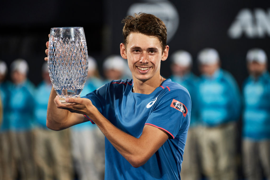 SYDNEY, AUSTRALIA - JANUARY 12: Alex De Minaur of Australia poses with his trophy after victory in his Mens Final match against Andreas Seppi of Italy during day seven of the 2019 Sydney International at Sydney Olympic Park Tennis Centre on January 12, 2019 in Sydney, Australia. (Photo by Brett Hemmings/Getty Images)