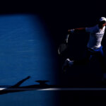 MELBOURNE, AUSTRALIA - JANUARY 19:  Novak Djokovic of plays a backhand serves in his third round match against Denis Shapovalov of Canada during day six of the 2019 Australian Open at Melbourne Park on January 19, 2019 in Melbourne, Australia.  (Photo by Michael Dodge/Getty Images)