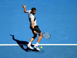 MELBOURNE, AUSTRALIA - JANUARY 20:  Grigor Dimitrov of Bulgaria plays a backhand in his fourth round match against Frances Tiafoe of the United States during day seven of the 2019 Australian Open at Melbourne Park on January 20, 2019 in Melbourne, Australia.  (Photo by Quinn Rooney/Getty Images)