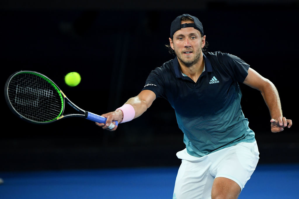 MELBOURNE, AUSTRALIA - JANUARY 25: Lucas Pouille of France plays a forehand in his men's semi final match against Novak Djokovic of Serbia during day 12 of the 2019 Australian Open at Melbourne Park on January 25, 2019 in Melbourne, Australia. (Photo by Quinn Rooney/Getty Images)