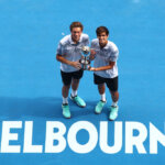 MELBOURNE, AUSTRALIA - JANUARY 27:  Pierre-Hugues Herbert and Nicolas Mahut of France pose with the championship trophy after their Men's Doubles Final match against John Peers of Australia and Henri Kontinen of Finland during day 14 of the 2019 Australian Open at Melbourne Park on January 27, 2019 in Melbourne, Australia.  (Photo by Scott Barbour/Getty Images)