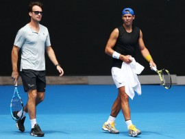 MELBOURNE, AUSTRALIA - JANUARY 10: Rafael Nadal of Spain  with coach Carlos Moya during a practice session ahead of the 2019 Australian Open at Melbourne Park on January 10, 2019 in Melbourne, Australia. (Photo by Michael Dodge/Getty Images)