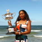 MELBOURNE, AUSTRALIA - JANUARY 27:  Naomi Osaka of Japan poses with the Daphne Akhurst Memorial Cup during the Women's Australian Open media opportunity at Brighton Beach on January 27, 2019 in Melbourne, Australia. (Photo by Julian Finney/Getty Images)