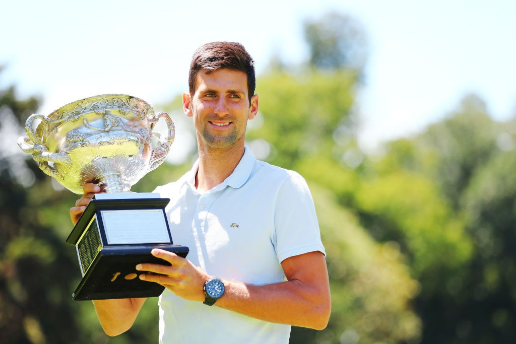 MELBOURNE, AUSTRALIA - JANUARY 28: Novak Djokovic of Serbia poses with the Norman Brookes Challenge Cup after winning the 2019 Australian Open at Picnic Point, Royal Botanical Gardens on January 28, 2019 in Melbourne, Australia. (Photo by Michael Dodge/Getty Images)