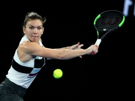 MELBOURNE, AUSTRALIA - JANUARY 17:  Simona Halep of Romania plays a backhand in her second round match against Sofia Kenin of the United States during day four of the 2019 Australian Open at Melbourne Park on January 17, 2019 in Melbourne, Australia.  (Photo by Cameron Spencer/Getty Images)
