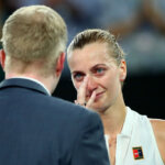 MELBOURNE, AUSTRALIA - JANUARY 22:  Petra Kvitova of the Czech Republic is interviewed by Jim Courier after winning her quarter final match against Ashleigh Barty of Australia during day nine of the 2019 Australian Open at Melbourne Park on January 22, 2019 in Melbourne, Australia.  (Photo by Cameron Spencer/Getty Images)