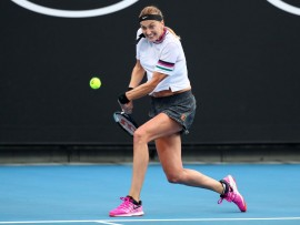 MELBOURNE, AUSTRALIA - JANUARY 16:  Petra Kvitova of the Czech Republic plays a backhand in her second round match against Irina-Camelia Begu of Romania during day three of the 2019 Australian Open at Melbourne Park on January 16, 2019 in Melbourne, Australia.  (Photo by Michael Dodge/Getty Images)