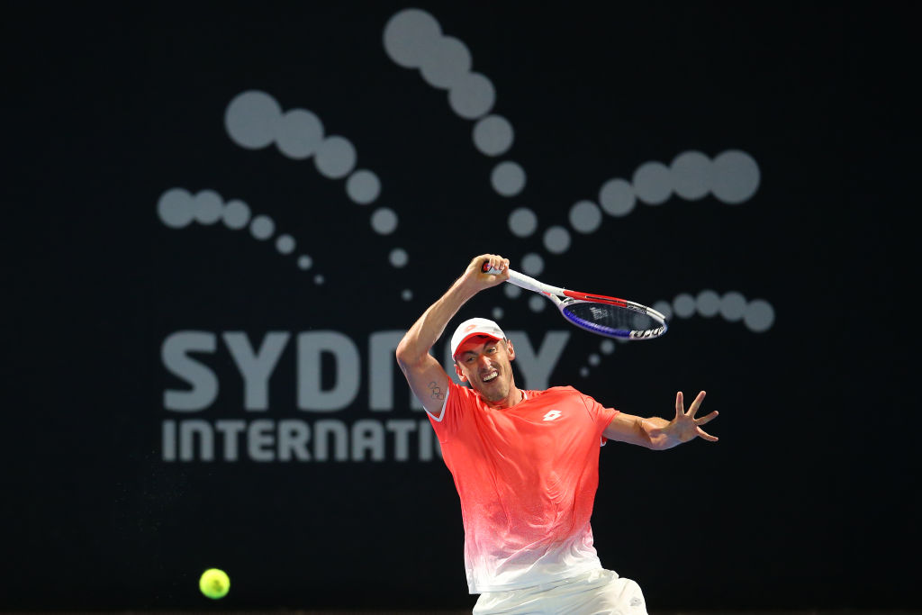 SYDNEY, AUSTRALIA - JANUARY 10: John Millman of Australia plays a shot in his match against Gilles Simon of France during day five of the 2019 Sydney International at the Sydney Olympic Tennis Centre on January 10, 2019 in Sydney, Australia. (Photo by Jason McCawley/Getty Images)
