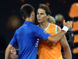 MELBOURNE, AUSTRALIA - JANUARY 27:  Novak Djokovic of Serbia is congratulated in his Men's Singles Final match by Rafael Nadal of Spain during day 14 of the 2019 Australian Open at Melbourne Park on January 27, 2019 in Melbourne, Australia. (Photo by Julian Finney/Getty Images)