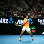 MELBOURNE, AUSTRALIA - JANUARY 16: Rafael Nadal of Spain plays a backhand during his second round match against Matthew Ebden of Australia during day three of the 2019 Australian Open at Melbourne Park on January 16, 2019 in Melbourne, Australia. (Photo by Cameron Spencer/Getty Images)