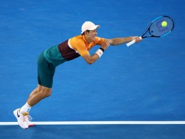 MELBOURNE, AUSTRALIA - JANUARY 21: Kei Nishikori of Japan plays a backhand in his fourth round match against Pablo Carreno Busta of Spain during day eight of the 2019 Australian Open at Melbourne Park on January 21, 2019 in Melbourne, Australia. (Photo by Cameron Spencer/Getty Images)