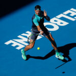 MELBOURNE, AUSTRALIA - JANUARY 19:  Milos Raonic of Canada plays a forehand in his third round match against Pierre-Hugues Herbert of France during day six of the 2019 Australian Open at Melbourne Park on January 19, 2019 in Melbourne, Australia.  (Photo by Darrian Traynor/Getty Images)