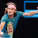 MELBOURNE, AUSTRALIA - JANUARY 20:  Stefanos Tsitsipas of Greece plays a backhand in his fourth round match against Roger Federer of Switzerland during day seven of the 2019 Australian Open at Melbourne Park on January 20, 2019 in Melbourne, Australia.  (Photo by Darrian Traynor/Getty Images)