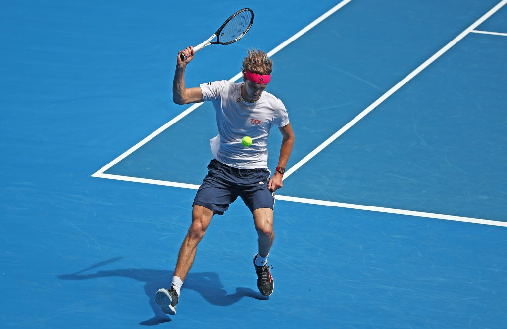 MELBOURNE, AUSTRALIA - JANUARY 10: Alexander Zverev of Germany plays a shot between his legs during his exhibition match ahead of the 2019 Australian Open at Melbourne Park on January 10, 2019 in Melbourne, Australia. (Photo by Scott Barbour/Getty Images)
