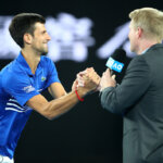 MELBOURNE, AUSTRALIA - JANUARY 23:  Novak Djokovic of Serbia is interviewed by Jim Courier following his quarter final match against Kei Nishikori of Japan during day 10 of the 2019 Australian Open at Melbourne Park on January 23, 2019 in Melbourne, Australia.  (Photo by Julian Finney/Getty Images)
