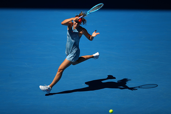 MELBOURNE, AUSTRALIA - JANUARY 14: Maria Sharapova of Russia plays a forehand in her first round match against Harriet Dart of Great Britain during day one of the 2019 Australian Open at Melbourne Park on January 14, 2019 in Melbourne, Australia. (Photo by Julian Finney/Getty Images)