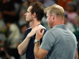 MELBOURNE, AUSTRALIA - JANUARY 14:  Andy Murray of Great Britain watches a tribute video after losing his first round match against Roberto Bautista Agut of Spain during day one of the 2019 Australian Open at Melbourne Park on January 14, 2019 in Melbourne, Australia.  (Photo by Cameron Spencer/Getty Images)