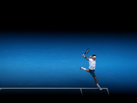 MELBOURNE, AUSTRALIA - JANUARY 16:  Roger Federer of Switzerland plays a backhand in his second round match against Daniel Evans of Great Britain during day three of the 2019 Australian Open at Melbourne Park on January 16, 2019 in Melbourne, Australia.  (Photo by Cameron Spencer/Getty Images)