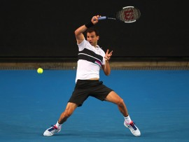 MELBOURNE, AUSTRALIA - JANUARY 16:  Grigor Dimitrov of Bulgaria plays a forehand in his second round match against Pablo Cuevas of Uruguay during day three of the 2019 Australian Open at Melbourne Park on January 16, 2019 in Melbourne, Australia.  (Photo by Michael Dodge/Getty Images)