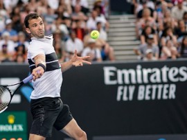 MELBOURNE, AUSTRALIA - JANUARY 16: Grigor Dimitrov of Bulgaria plays a forehand in his second round match against Pablo Cuevas of Uruguay during day three of the 2019 Australian Open at Melbourne Park on January 16, 2019 in Melbourne, Australia.  (Photo by Fred Lee/Getty Images)
