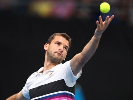 MELBOURNE, AUSTRALIA - JANUARY 18:  Grigor Dimitrov of Bulgaria serves in his third round match against Thomas Fabbiano of Italy during day five of the 2019 Australian Open at Melbourne Park on January 18, 2019 in Melbourne, Australia.  (Photo by Michael Dodge/Getty Images)
