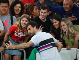 MELBOURNE, AUSTRALIA - JANUARY 18:  Grigor Dimitrov of Bulgaria poses for a selfie with spectators winning his third round match against Thomas Fabbiano of Italy during day five of the 2019 Australian Open at Melbourne Park on January 18, 2019 in Melbourne, Australia.  (Photo by Michael Dodge/Getty Images)