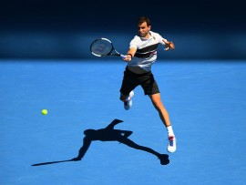 MELBOURNE, AUSTRALIA - JANUARY 20:  Grigor Dimitrov of Bulgaria plays a forehand in his fourth round match against Frances Tiafoe of the United States during day seven of the 2019 Australian Open at Melbourne Park on January 20, 2019 in Melbourne, Australia.  (Photo by Quinn Rooney/Getty Images)