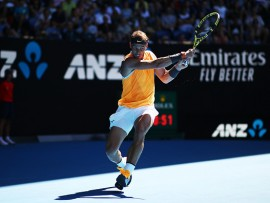 MELBOURNE, AUSTRALIA - JANUARY 20:  Rafael Nadal of Spain plays a backhand in his fourth round match against Tomas Berdych of the Czech Republic during day seven of the 2019 Australian Open at Melbourne Park on January 20, 2019 in Melbourne, Australia.  (Photo by Julian Finney/Getty Images)