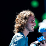 MELBOURNE, AUSTRALIA - JANUARY 22:  Stefanos Tsitsipas of Greece is interviewed following his quarter final match against Roberto Bautista Agut of Spain during day nine of the 2019 Australian Open at Melbourne Park on January 22, 2019 in Melbourne, Australia. (Photo by Fred Lee/Getty Images)