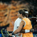 MELBOURNE, AUSTRALIA - JANUARY 22: Rafael Nadal of Spain and Frances Tiafoe of the United States embrace at the net following their quarter final match during day nine of the 2019 Australian Open at Melbourne Park on January 22, 2019 in Melbourne, Australia.(Photo by Fred Lee/Getty Images)
