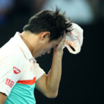 MELBOURNE, AUSTRALIA - JANUARY 23:  Kei Nishikori of Japan wipes his face after retiring from his quarter final match against Novak Djokovic of Serbia during day 10 of the 2019 Australian Open at Melbourne Park on January 23, 2019 in Melbourne, Australia.  (Photo by Julian Finney/Getty Images)