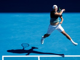 MELBOURNE, AUSTRALIA - JANUARY 23: Lucas Pouille of France plays a forehand in his quarter final match against Milos Raonic of Canada during day 10 of the 2019 Australian Open at Melbourne Park on January 23, 2019 in Melbourne, Australia. (Photo by Fred Lee/Getty Images)