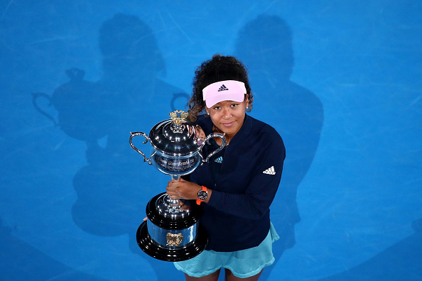 MELBOURNE, AUSTRALIA - JANUARY 26:  Naomi Osaka of Japan poses for a photo with the Daphne Akhurst Memorial Cup following victory in her Women's Singles Final match against Petra Kvitova of the Czech Republic during day 13 of the 2019 Australian Open at Melbourne Park on January 26, 2019 in Melbourne, Australia.  (Photo by Cameron Spencer/Getty Images)