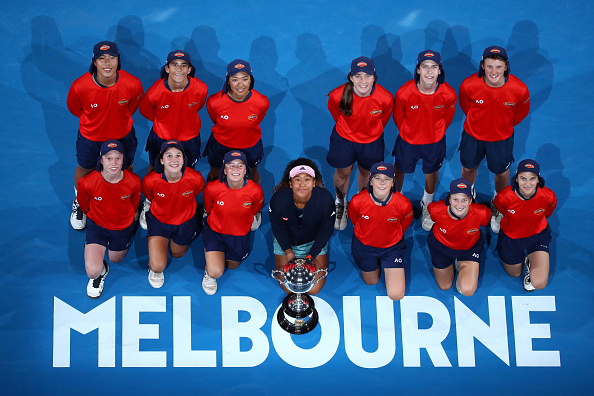 MELBOURNE, AUSTRALIA - JANUARY 26:  Naomi Osaka of Japan poses for a photo with the Daphne Akhurst Memorial Cup and the ball kids following victory in her Women's Singles Final match against Petra Kvitova of the Czech Republic during day 13 of the 2019 Australian Open at Melbourne Park on January 26, 2019 in Melbourne, Australia.  (Photo by Cameron Spencer/Getty Images)