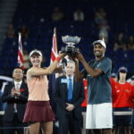 MELBOURNE, AUSTRALIA - JANUARY 26: Barbora Krejcikova of Czech Republic and Rajeev Ram of the United States pose with the championship trophy after winning their Mixed Doubles Final match against Astra Sharma and John-Patrick Smith of Australia during day 13 of the 2019 Australian Open at Melbourne Park on January 26, 2019 in Melbourne, Australia.(Photo by Fred Lee/Getty Images)