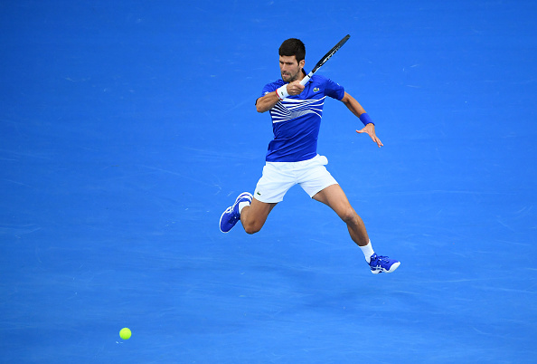 MELBOURNE, AUSTRALIA - JANUARY 27: Novak Djokovic of Serbia plays a forehand in his Men's Singles Final match against Rafael Nadal of Spain during day 14 of the 2019 Australian Open at Melbourne Park on January 27, 2019 in Melbourne, Australia. (Photo by Quinn Rooney/Getty Images)
