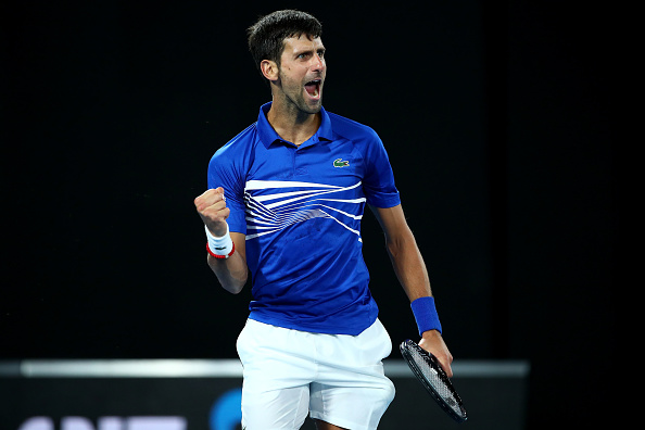 MELBOURNE, AUSTRALIA - JANUARY 27: Novak Djokovic of Serbia celebrates a point in his Men's Singles Final match against Rafael Nadal of Spain during day 14 of the 2019 Australian Open at Melbourne Park on January 27, 2019 in Melbourne, Australia. (Photo by Cameron Spencer/Getty Images)