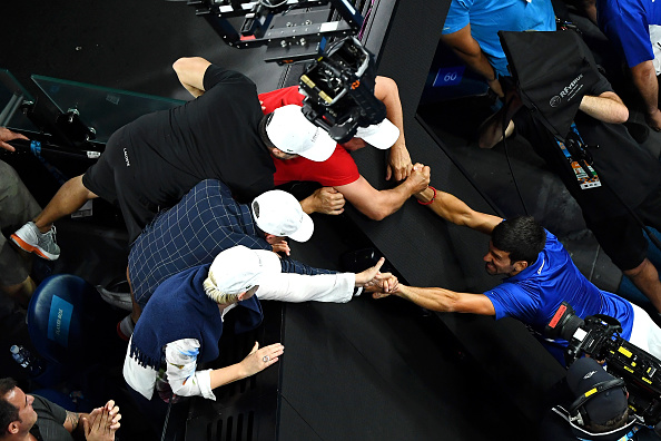 MELBOURNE, AUSTRALIA - JANUARY 27: Novak Djokovic of Serbia celebrates victory with his team following his Men's Singles Final match against Rafael Nadal of Spain during day 14 of the 2019 Australian Open at Melbourne Park on January 27, 2019 in Melbourne, Australia. (Photo by Quinn Rooney/Getty Images)