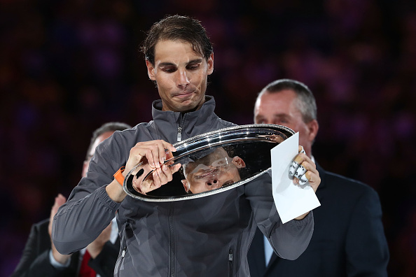 MELBOURNE, AUSTRALIA - JANUARY 27: Rafael Nadal of Spain poses with the runners-up trophy following defeat in his Men's Singles Final match against Novak Djokovic of Serbia during day 14 of the 2019 Australian Open at Melbourne Park on January 27, 2019 in Melbourne, Australia. (Photo by Cameron Spencer/Getty Images)