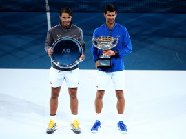 MELBOURNE, AUSTRALIA - JANUARY 27: Rafael Nadal of Spain, holding the runners-up trophy (L) and Novak Djokovic of Serbia, holding the Norman Brookes Challenge Cup pose for a photo following their Men's Singles Final match during day 14 of the 2019 Australian Open at Melbourne Park on January 27, 2019 in Melbourne, Australia.  (Photo by Scott Barbour/Getty Images)