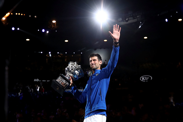 MELBOURNE, AUSTRALIA - JANUARY 27: Novak Djokovic of Serbia poses with the Norman Brookes Challenge Cup following victory in his Men's Singles Final match against Rafael Nadal of Spain during day 14 of the 2019 Australian Open at Melbourne Park on January 27, 2019 in Melbourne, Australia. (Photo by Cameron Spencer/Getty Images)