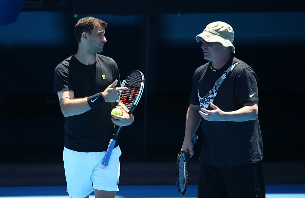 MELBOURNE, AUSTRALIA - JANUARY 09: Grigor Dimitrov of Bulgaria talks with his coach Andre Agassi during a practice session ahead of the 2019 Australian Open at Melbourne Park on January 09, 2019 in Melbourne, Australia. (Photo by Scott Barbour/Getty Images)