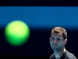 MELBOURNE, AUSTRALIA - JANUARY 09: Grigor Dimitrov of Bulgaria watches the ball during a practice session ahead of the 2019 Australian Open at Melbourne Park on January 09, 2019 in Melbourne, Australia. (Photo by Scott Barbour/Getty Images)