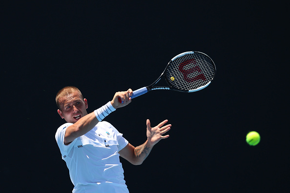 MELBOURNE, AUSTRALIA - JANUARY 10:  Daniel Evans of Great Britain plays a forehand in his match against Jurij Rodionov of Austria during day three of Qualifying ahead of the 219 Australian Open at Melbourne Park on January 10, 2019 in Melbourne, Australia. (Photo by Graham Denholm/Getty Images)