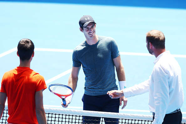 MELBOURNE, AUSTRALIA - JANUARY 10: Andy Murray of Great Britain reacts at the coin toss in his practice match against Novak Djokovic of Serbia ahead of the 2019 Australian Open at Melbourne Park on January 10, 2019 in Melbourne, Australia. (Photo by Michael Dodge/Getty Images)