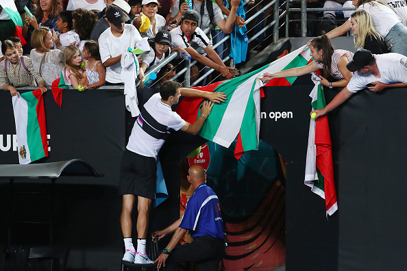 MELBOURNE, AUSTRALIA - JANUARY 16: Grigor Dimitrov of Bulgaria signs autographs for fans after winning his second round match against Pablo Cuevas of Uruguayduring day three of the 2019 Australian Open at Melbourne Park on January 16, 2019 in Melbourne, Australia. (Photo by Michael Dodge/Getty Images)