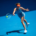 "MELBOURNE, AUSTRALIA - JANUARY 20:  Maria Sharapova of Russia hits a forehand to Ashleigh Barty of Australia during day seven of the 2019 Australian Open at Melbourne Park on January 20, 2019 in Melbourne, Australia. (Photo by TPN/Getty Images)""n""n""n""n"